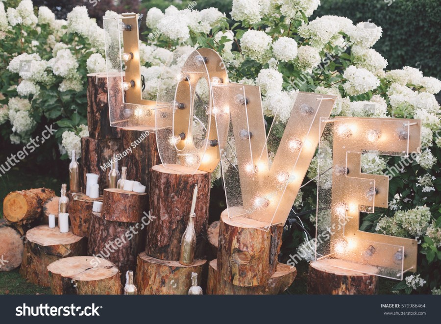 stock-photo-decorated-meadow-for-wedding-ceremony-579986464.jpg