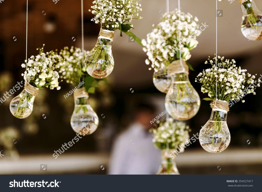 stock-photo-original-wedding-floral-decoration-in-the-form-of-mini-vases-and-bouquets-of-flowers-hanging-from-354527417.jpg