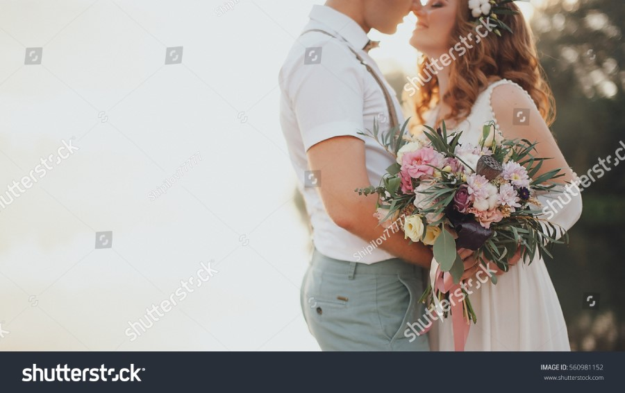 stock-photo-the-bride-and-groom-on-the-background-of-a-mountain-stream-560981152.jpg