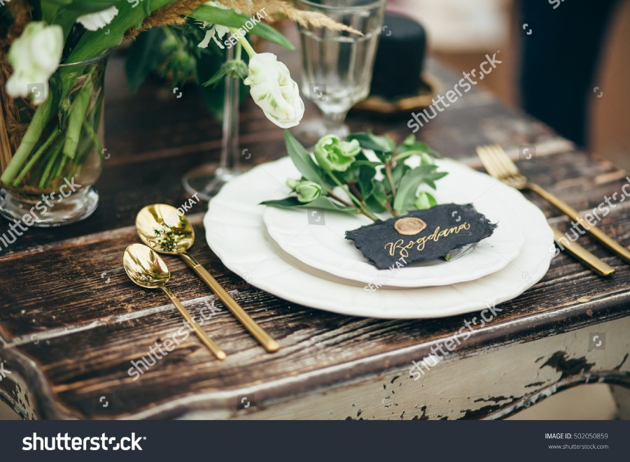 stock-photo-wedding-decor-flowers-black-and-gold-decor-candles-502050859.jpg